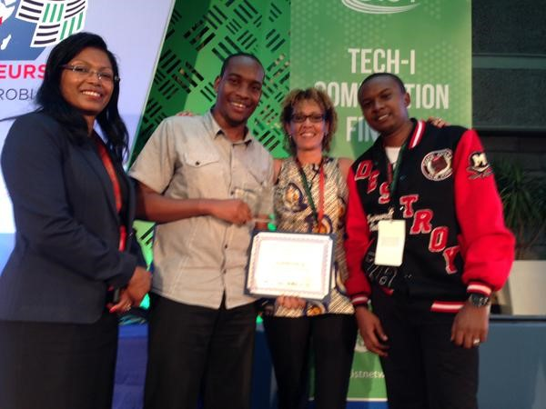 All smiles for Taita as he receives an award for Illuminum Greenhouses. From Left: Eunice Kariuki, Deputy CEO/Marketing Director at ICT Authority; Taita Ngetich, Sue Kahumbu Stephanou, Founder of I-Cow, and Stephen Kariuki