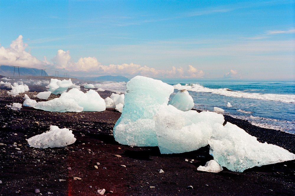 Icelands curiously black sanded beaches also happen to wash up Icebergs on the shore (1).jpg