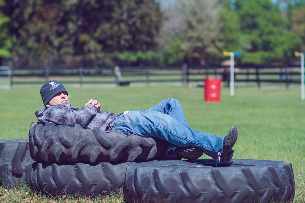"Executive Director and Combat Wounded Veteran, Travis Harvey, staying warm on the tires, while watching a veteran ride.  ""There is no nobler a thing, than service to our fellow man.  I found my home serving my local brethren at Horses Helping People."""