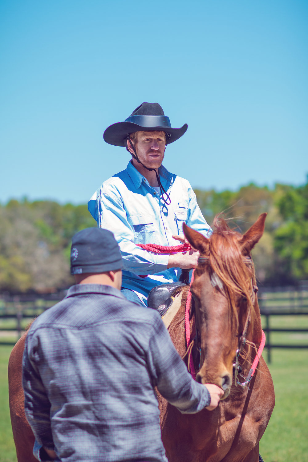 Veteran Bryan and Executive Director Travis talking during Equine Assisted Learning.