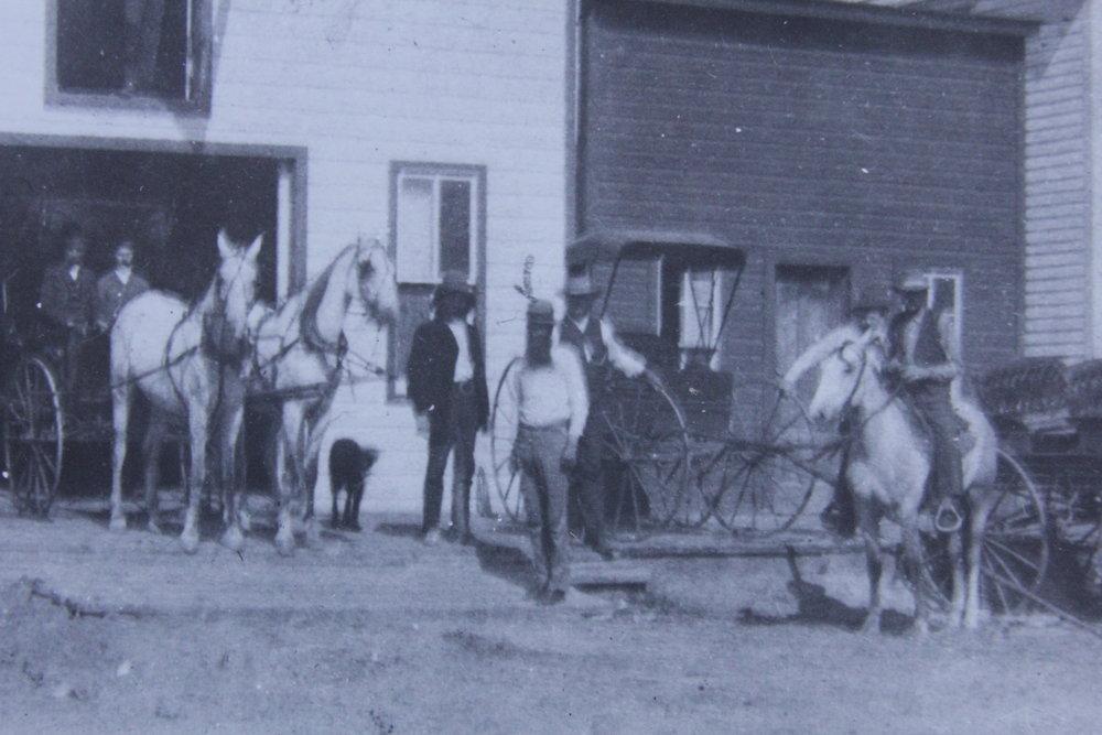 Doc Middleton & friends outside barn on Main Street Gordon, 1892