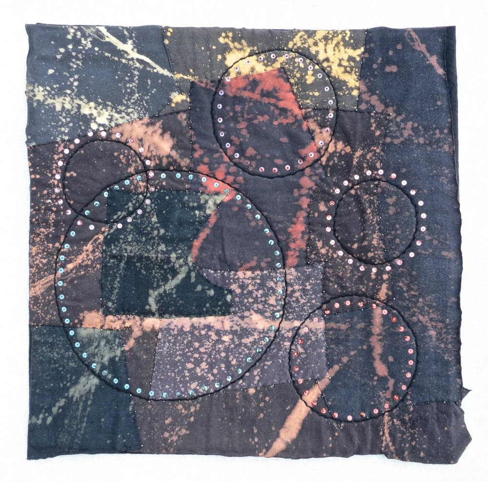 "Black T Boro: Splat and Spin   2014 20.5"" x 20.5""  Repurposed cotton t-shirts appliqué, rayon thread embroidery with vintage sequins and glass beads."