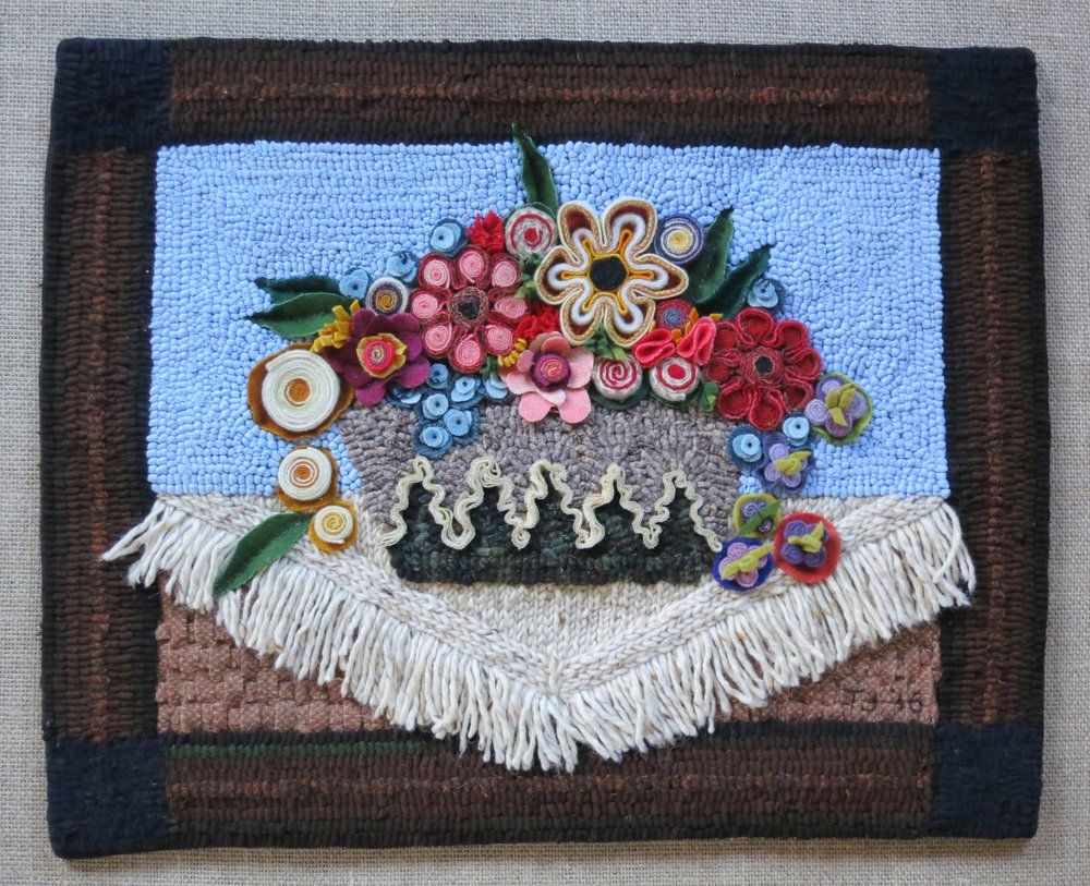 "Frank's Flower Pot 2016 16"" x 20"" Wool coiled, standing wool, chain stitched, bias shirred, woven, bundle shirred, fringed and appliqued; cotton knit hand hooked.  Frank's Flower Pot finished, pattern available in Shop Section."