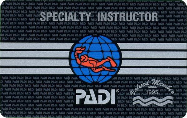 A master scuba diver trainer certification card with the PADI logo in the center of it. Coconut tree divers are the only shop in roatan that offers specialty diving.