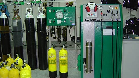 a compressor room filled with nitrox and helium tanks that you can earn a certification with coconut tree divers in roatan, honduras.