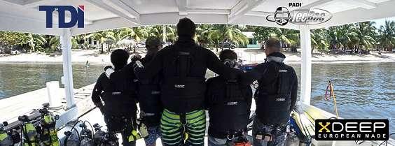 roatan tec center employees on the boat in xdeep sidemount gear