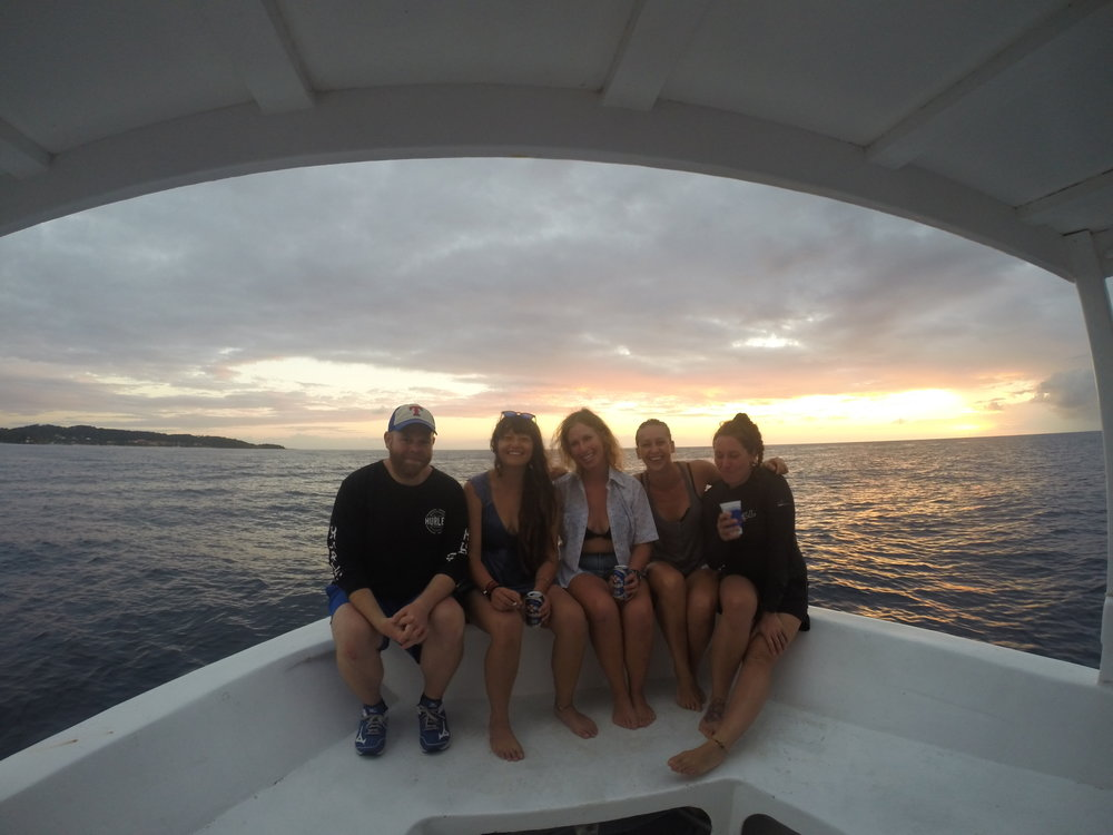 Divemasters enjoying a sunset cruise with the staff after a fun day of diving.