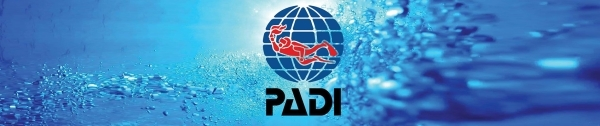 A PADI logo and banner with scuba diving bubbles in the background.