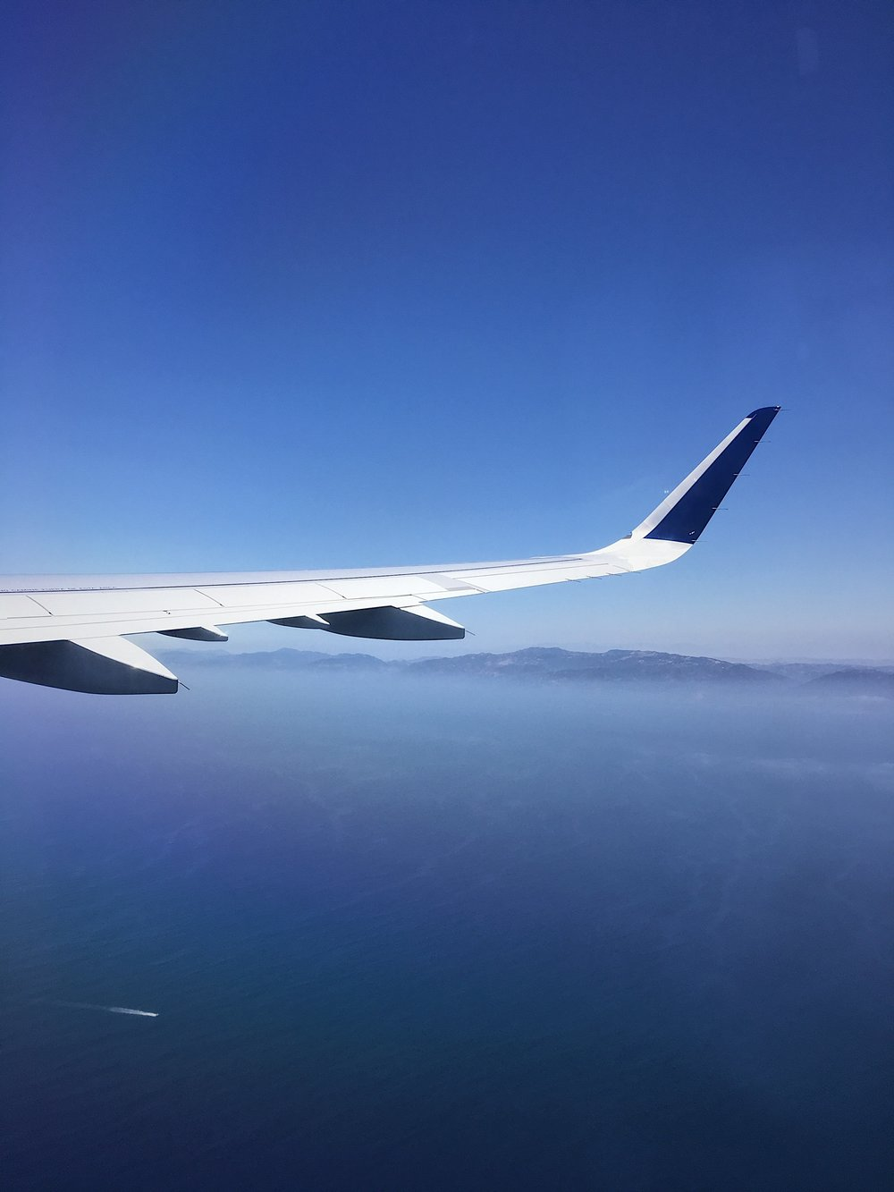 Window view of the Pacific Ocean after taking off, before turning around to head to NY