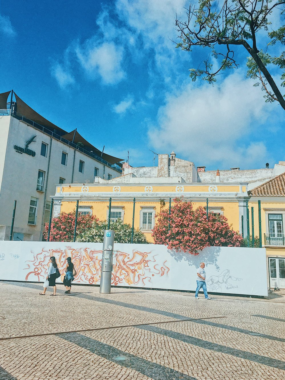 Colorful buildings and graffiti in Faro by the port