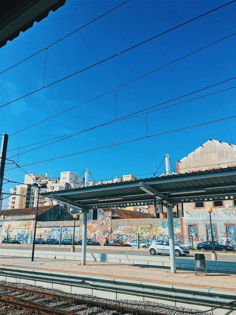 A colorful city: waiting at the Faro station for our train back to Lisb  on