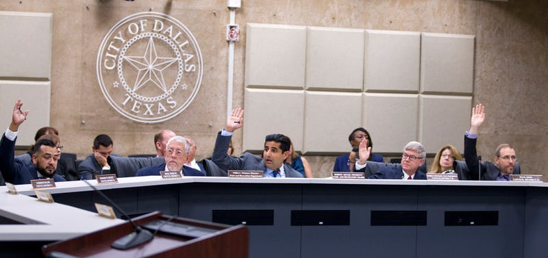 Park Board President Bobby Abtahi (center) calls for a vote on sending the Fair Park First-Spectra contract to the City Council. (Shaban Athuman/Staff Photographer, Dallas Morning News)