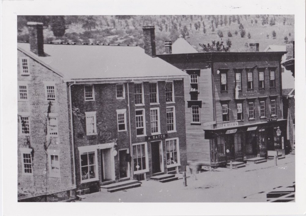 The upper floor of the building on the right was called Union Hall and was used for a time as the headquarters of the town's cavalry troops.