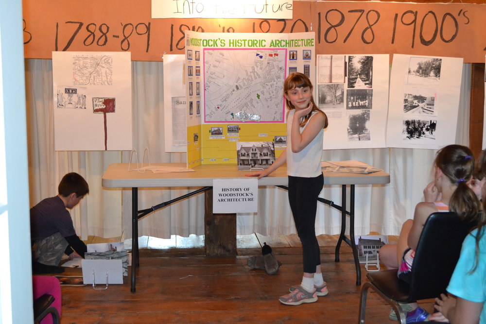 A Fourth Grade History Fair group presenting Woodstock's Historic Architecture. 2014.