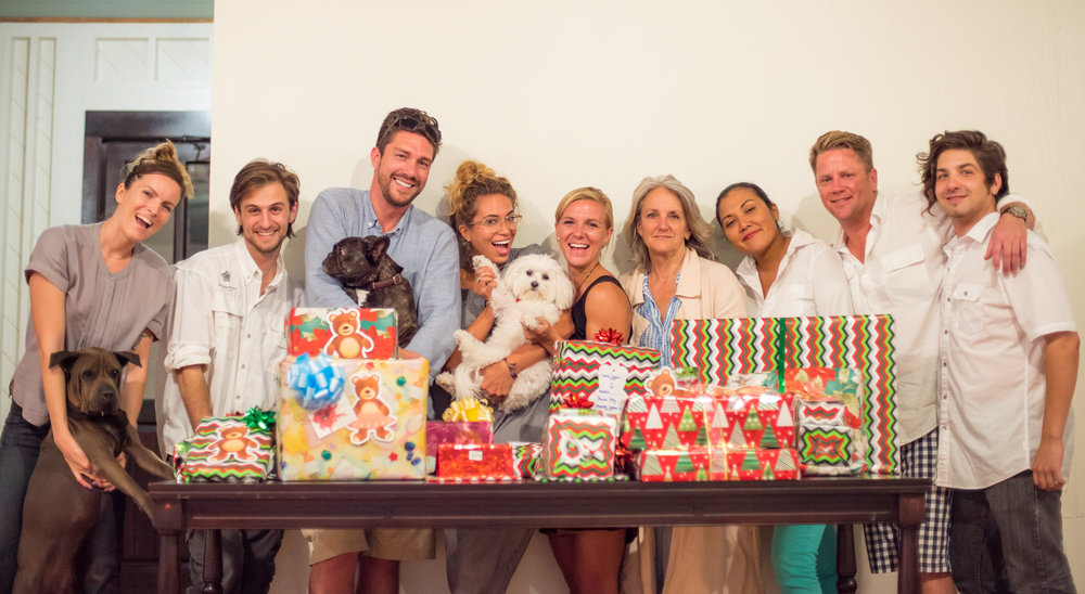 Developer & CEO, Beth Clifford, joins the Mahogany Bay Village Sales & Marketing team to wrap gift donations.
