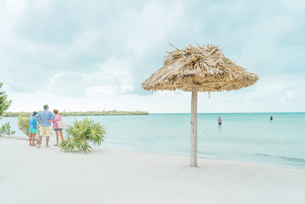 Coastal Living guests enjoy the turquoise waters of Mahogany Bay Village's Beach Club on the west side of Ambergris Caye.