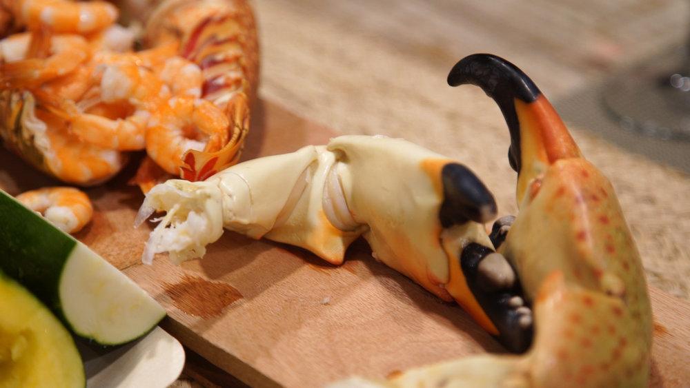 Stone crab gets prepared by sushi chef Toshiya Tsujimoto of JYOTO Japanese Restaurant at Mahogany Bay.