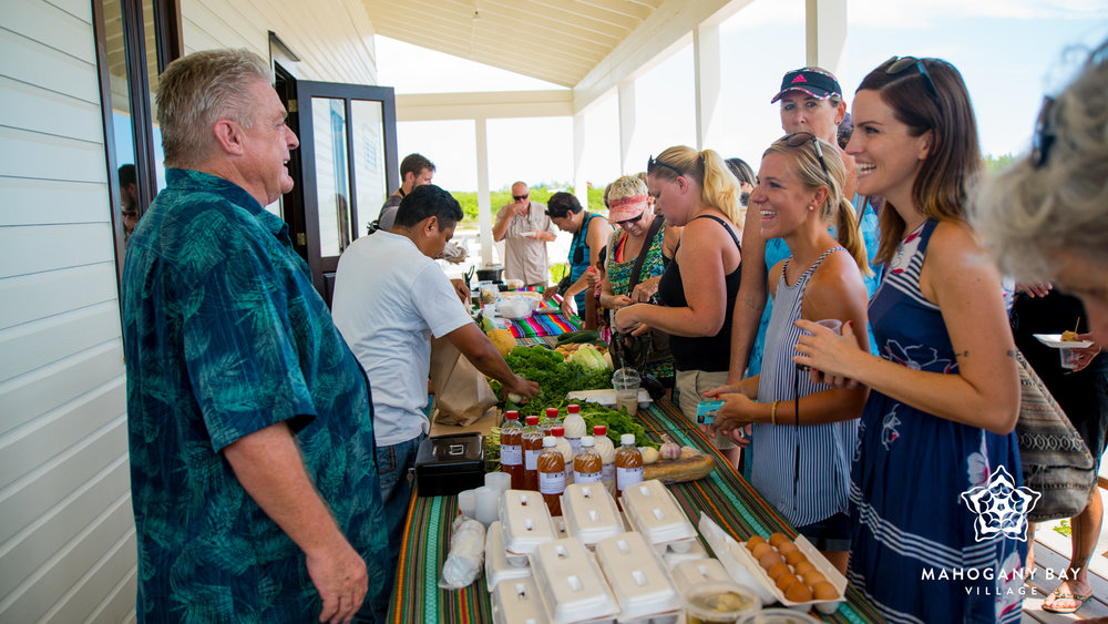 Ian Anderson hosts the first Mahogany Bay Market Day, with a wide variety of Farm House Deli goods.