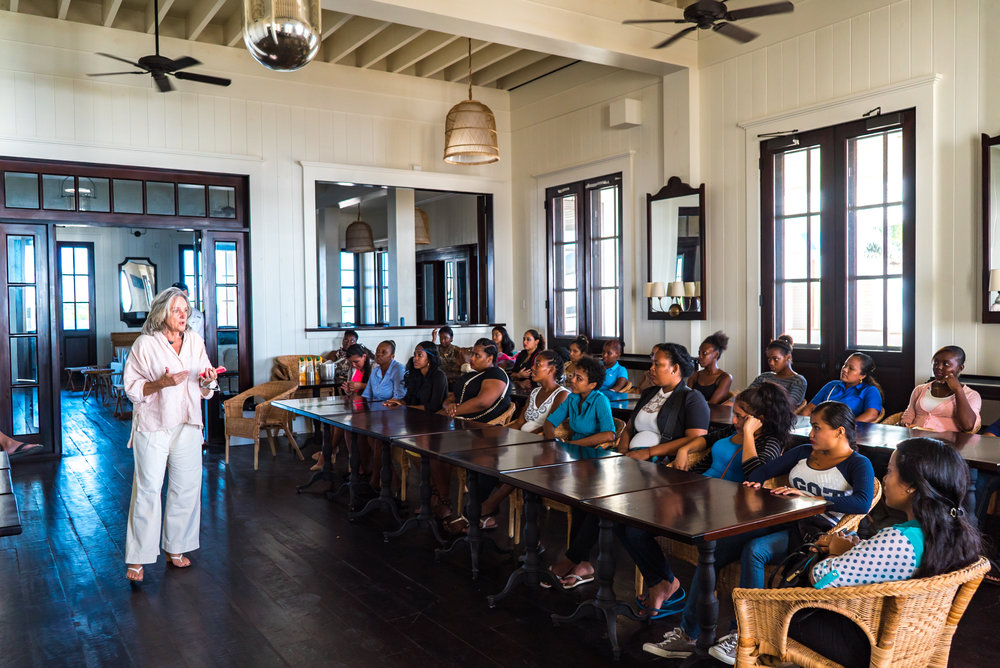 Mahogany Bay Village developer and CEO, Beth Clifford, gives a motivational talk to local women seeking employment on Ambergris Caye.