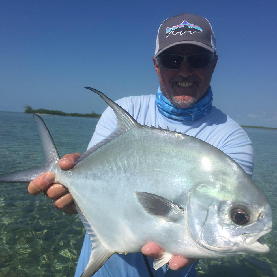 Chris Raines, co-owner of Blue Bonefish at Mahogany Bay Village, displays a permit caught just off the western flats of Ambergris Caye.