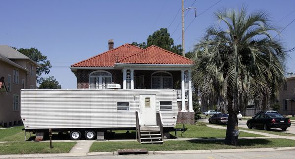 A FEMA trailer sits in front of a home in New Orleans' Lakeview section in this photo from 2009. Image courtesy of Bill Haber/Associated Press.