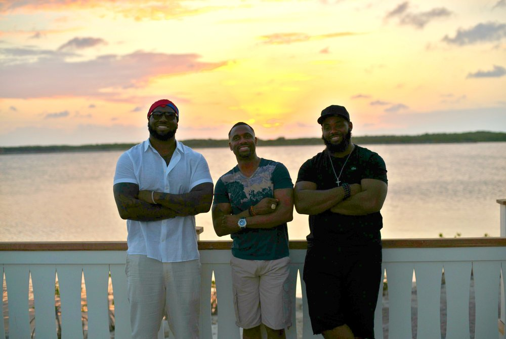 NFL players Henry Melton, Ray Crockett, and Terrell McClain enjoying their time at Mahogany Bay Village's pool and Bay Club in south Ambergris Caye.