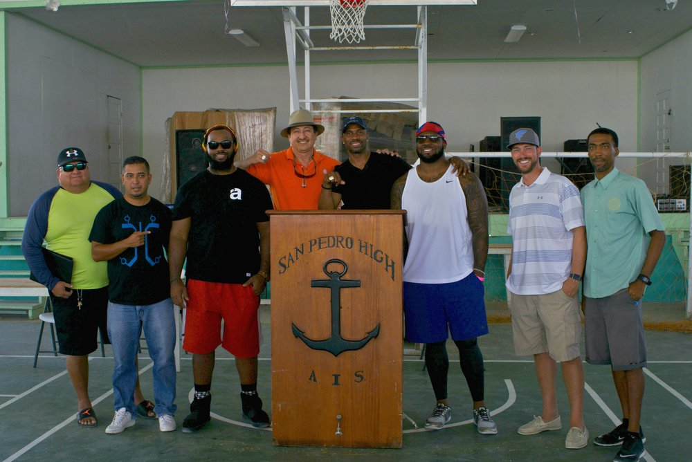 Mayor Danny Guerrero and his Board of Directors, San Pedro Town Council, along with the NFL players pose for a photo at Ray Crockett's motivational talk to the San Pedro High School students on Ambergris Caye.