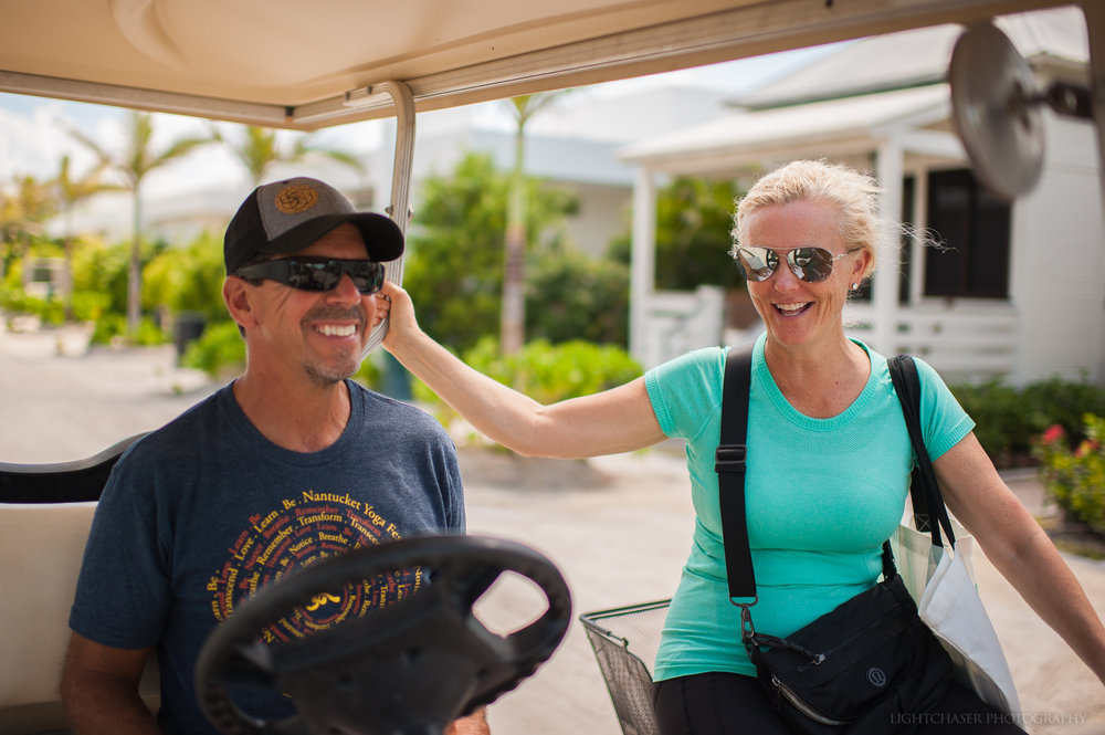 Steven Rigo and Paulette Harwood of Science and Soul Wellness jump on a golf cart at Mahogany Bay Village.