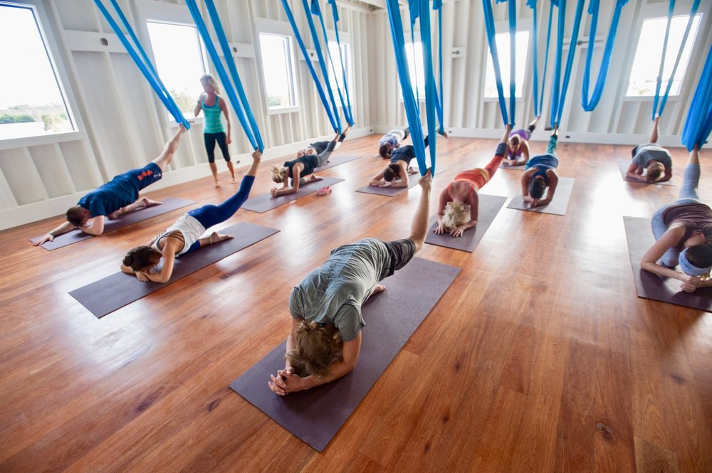 Aerial yoga at the Science & Soul Wellness loft, Mahogany Bay Village.