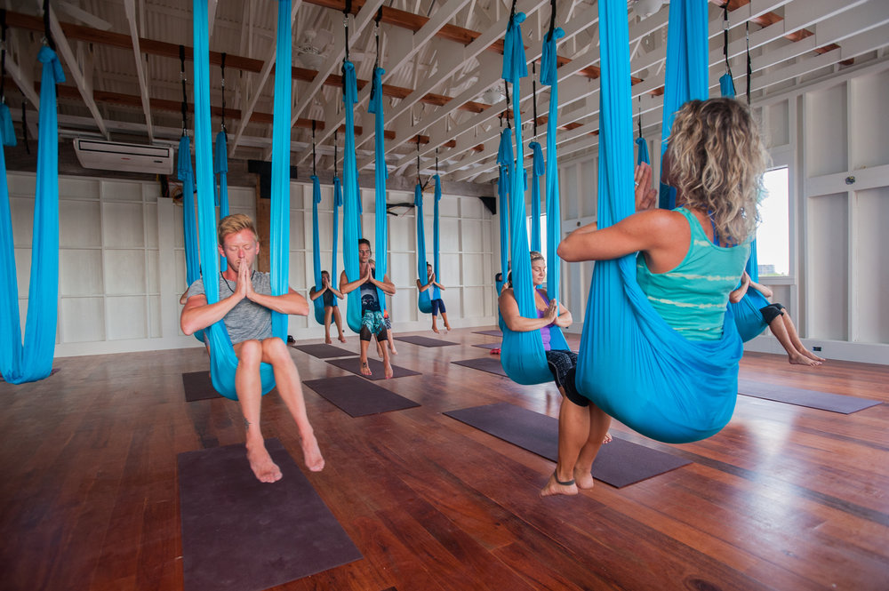 An aerial yoga class at Science and Soul Wellness.