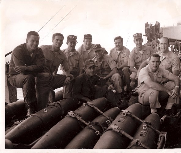 Dennis Connolly (fourth from right, mustache)aboard the USS Kitty Hawk off North Vietnam on a rare day off.