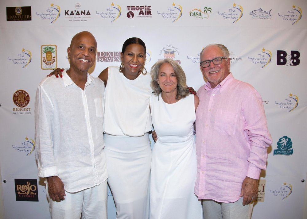 """Prime Minister of Belize, Dean Barrow; Kim Simplis-Barrow; Beth Clifford;Dennis Connolly at The Inspiration Celebration charity event at Mahogany Bay Village in 2016. Beth sums up this picture best:""""one of these things is not like the other . . ."""""""