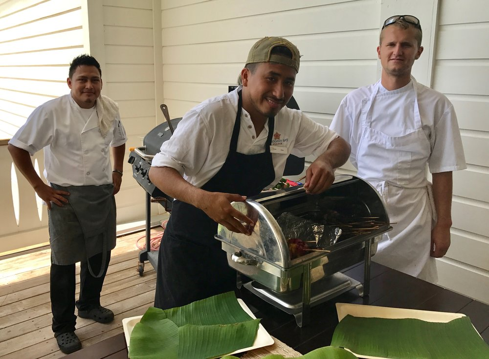 Alex and his colleagues Adiel Garcia (left) and Julian Oberlacher (right) preparing lunch for 50, earlier this summer at Mahogany Bay Village.
