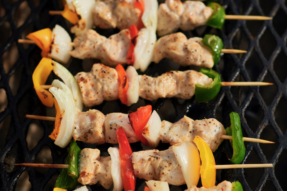 Alex's chicken kebabs on the grill at Mahogany Bay Beach Club on Ambergris Caye's west side.