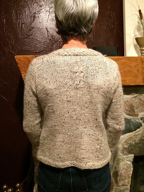 Owl pattern knit on  back of sweater