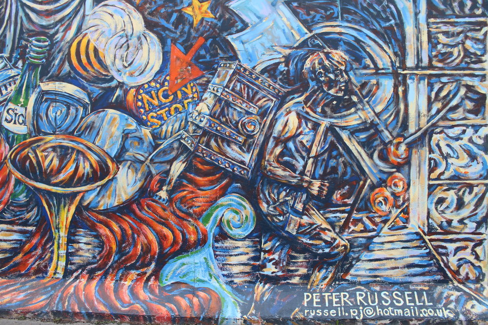 There was very little that I could find out on Peter Russell. However, this mural is called 'Himmel und Sucher', translated in English as 'Heaven and Seeker'.