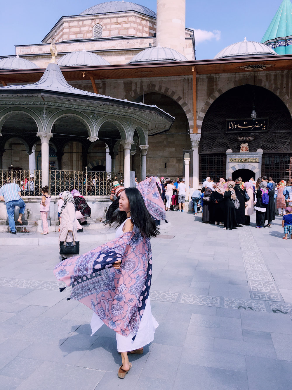 Sufi Whirling in front of Rumi's tomb, in Konya, Turkey