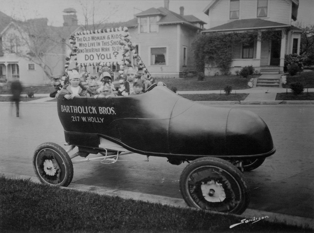 George Bartholick, age 4, (to the right of the steering wheel) in a Bellingham parade.