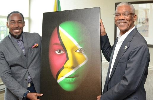 Page-1B-Canadian-artisan-Robert-Young-left-makes-a-presentation-to-Guyanas-president-David-Granger.jpg