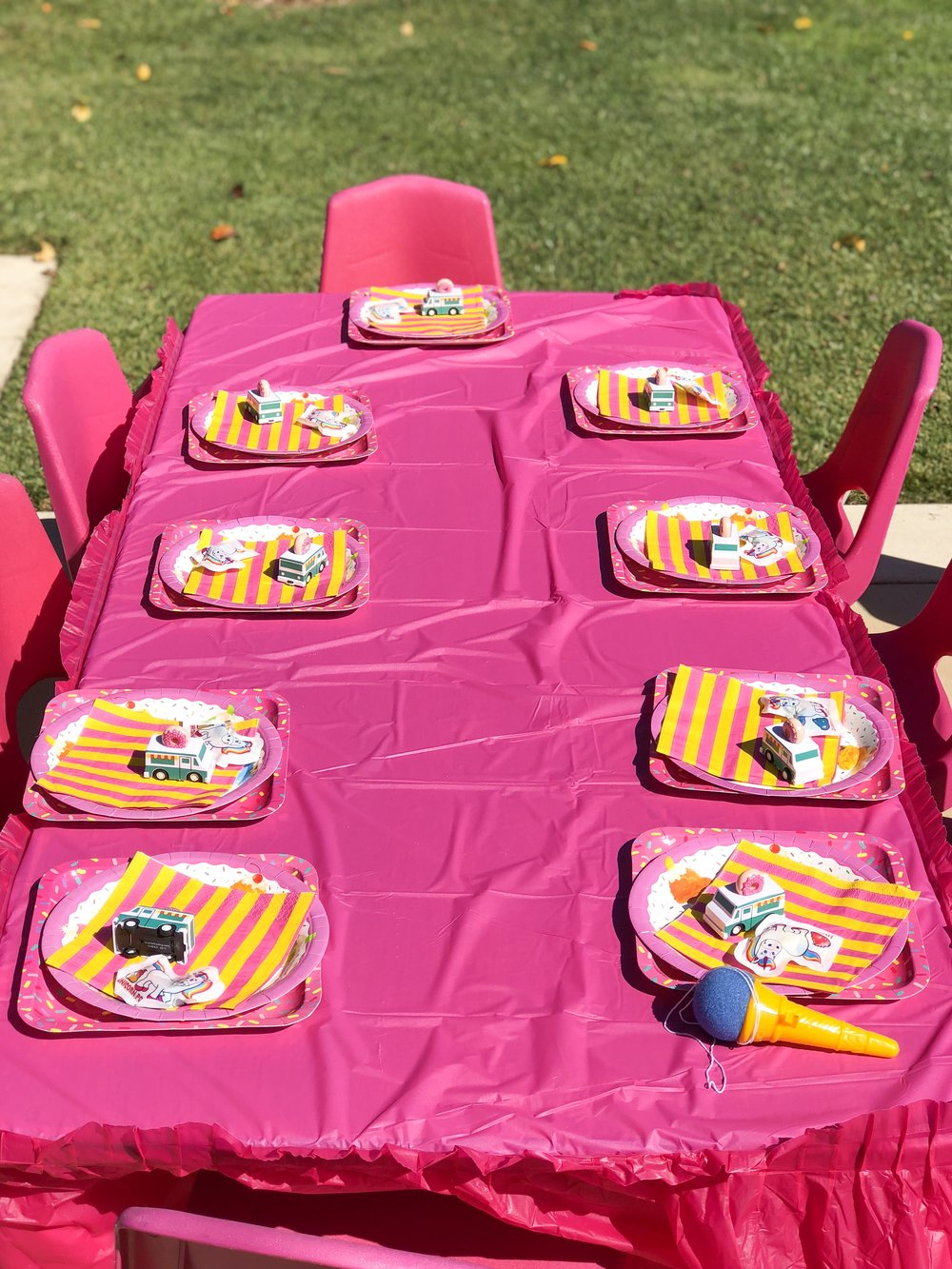 The Kids Tables were topped off with Little Donuts Push Trucks and Unicorn Poop!! (I had to get It) Also we opted for matching hot pink chairs!!  (BUT OF COURSE!!)