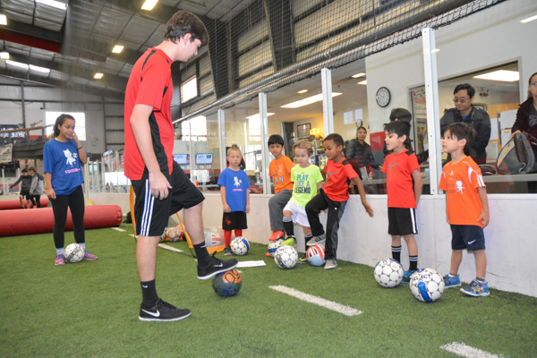 Coach Shows Students Soccer Drill