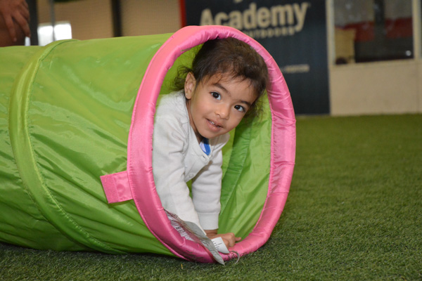 Girl Crawls Through Obstacle Course Tube