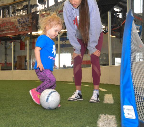 Girl Shoots Soccer Ball in Goal