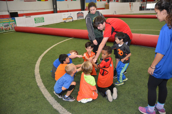 Soccer Cubs Students Bring it in After Class