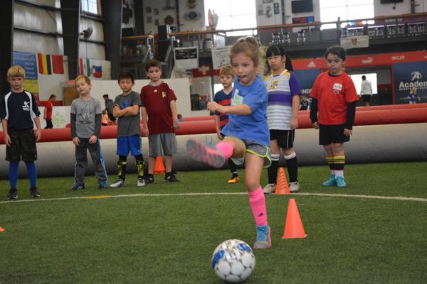 Girl Practices Shooting Soccer Ball