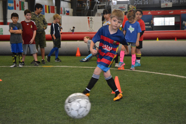 Boy Practices Soccer Shooting