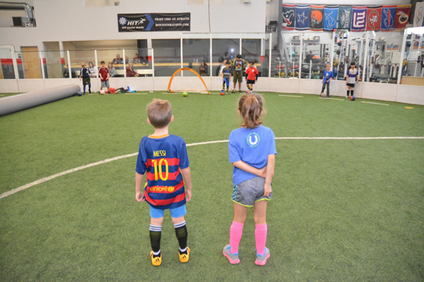 Boy and Girl Stand Facing the Field Goal