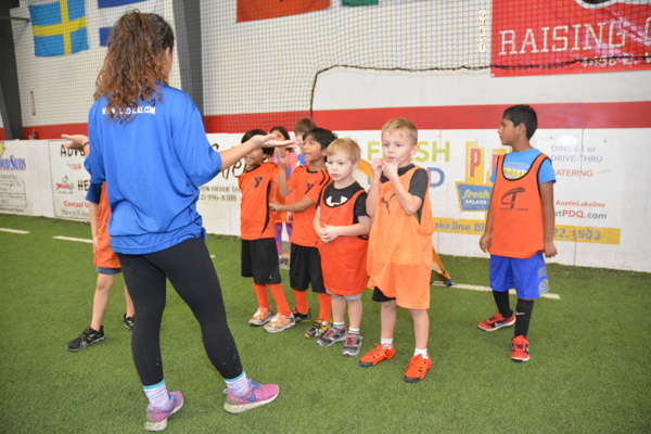 Coach Instructs A Group of Soccer Cubs Students