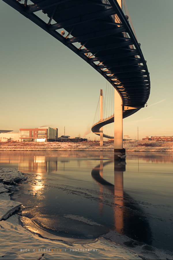 'icy pedestrian bridge at sunrise'