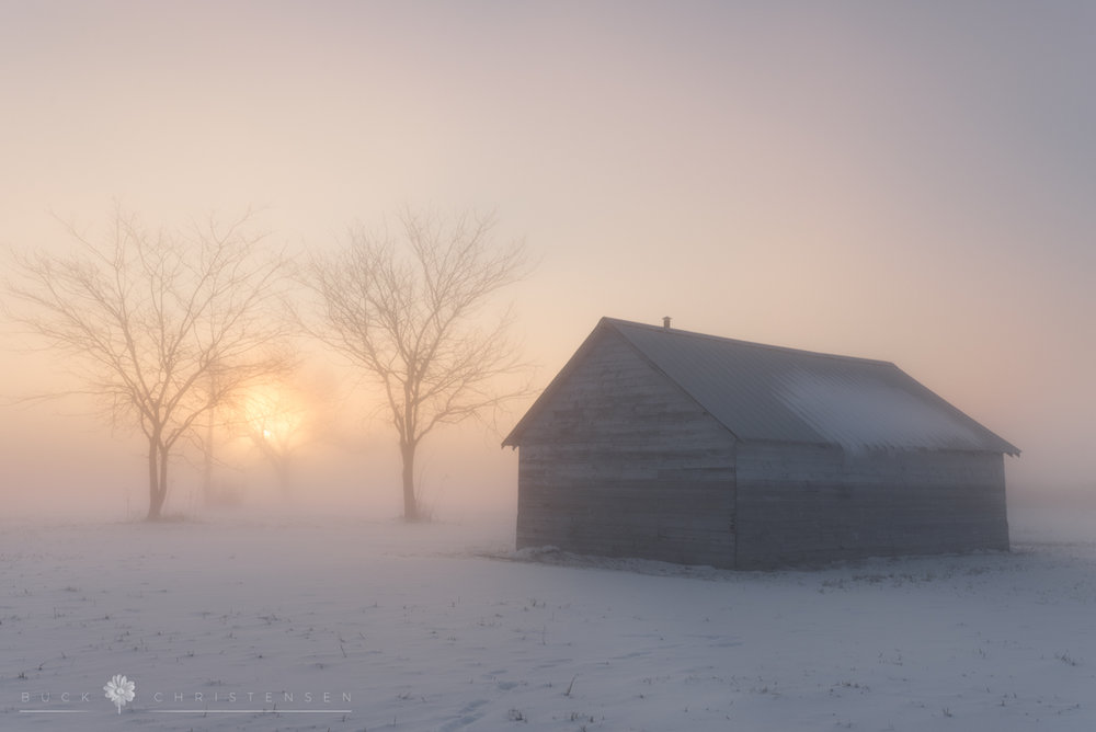 barn near Boyer Chute in Fort Calhoun Nebraska in the freezing fog at sunrise